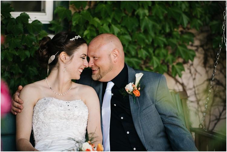 wedding-couple-sitting-on-swing-at-wisconsin-farm-wedding-by-appleton-wedding-photographer-kyra-rane-photography