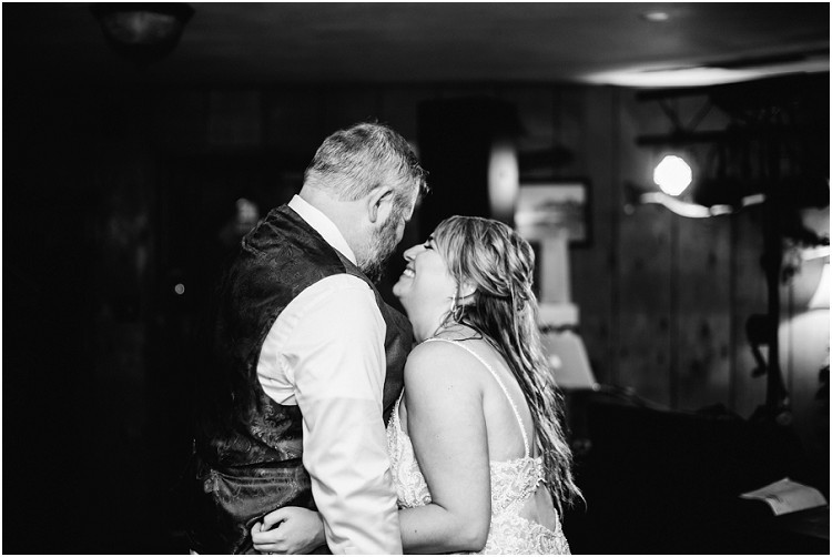 bride-and-groom-first-dance-at-northern-wisconsin-autumn-wedding-by-green-bay-wedding-photographer-kyra-rane-photography