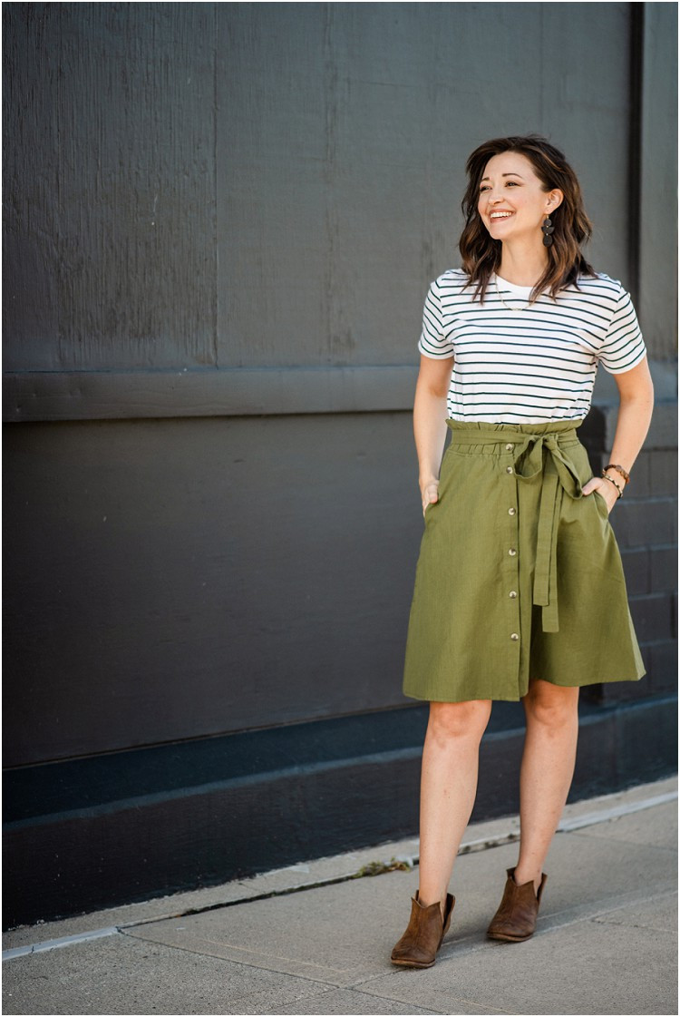smiling-away-from-camera-wearing-green-skirt-at-ethical-fashion-styled-shoot-by-milwaukee-wedding-photographer-kyra-rane-photography