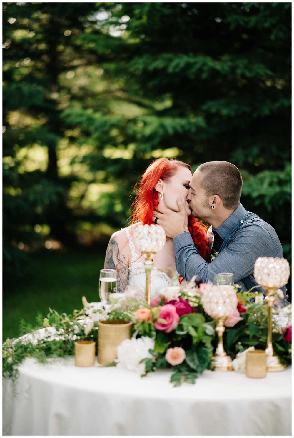 wedding-couple-kissing-at-table-at-homestead-meadows-styled-shoot-by-green-bay-wedding-photographer-kyra-rane-photography