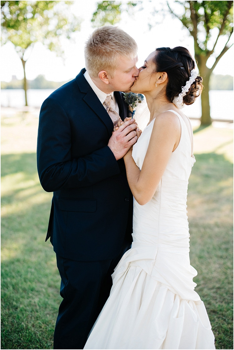 wedding-couple-share-kiss-at-de-pere-wedding-by-green-bay-wedding-photographer-kyra-rane-photography