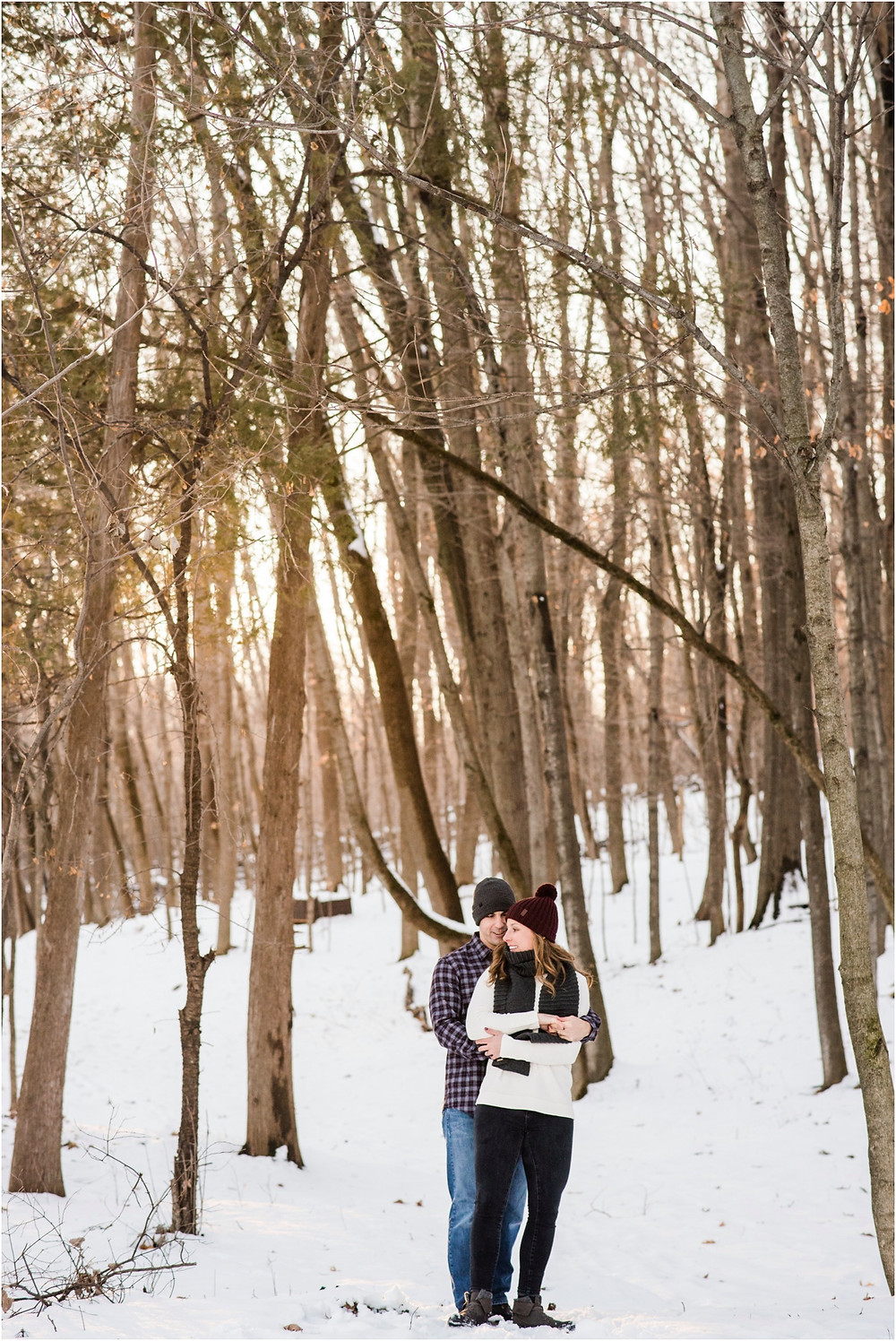 engaged-couple-cuddled-in-the-woods-at-pamperin-park-winter-engagement-session-by-appleton-wedding-photographer-kyra-rane-photography