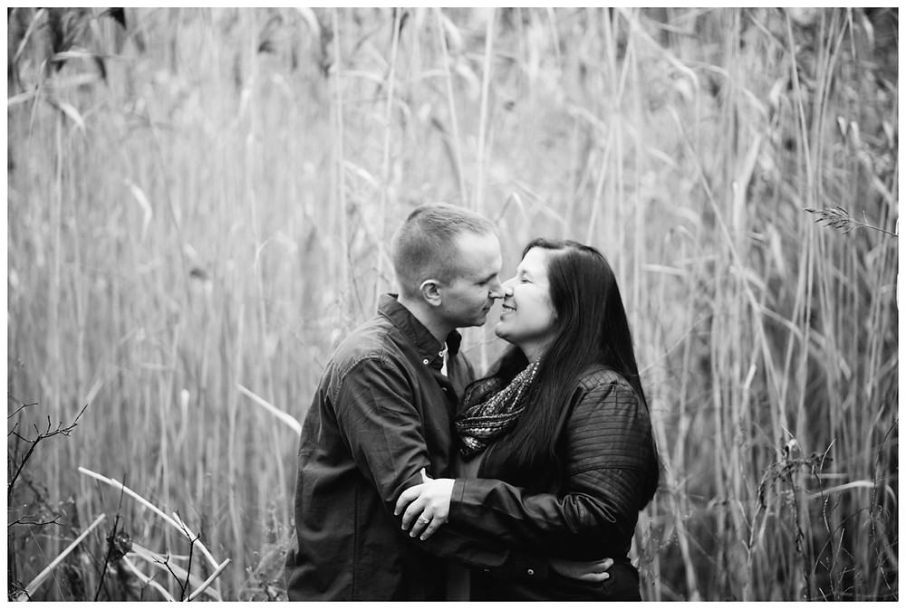engaged-couple-about-to-kiss-at-green-bay-engagement-session-by-appleton-wedding-photographer-kyra-rane-photography