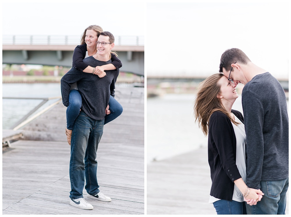 engaged-couple-holding-hands-smiling-at-each-other-at-downtown-green-bay-engagement-session-by-appleton-wedding-photographer-kyra-rane-photography