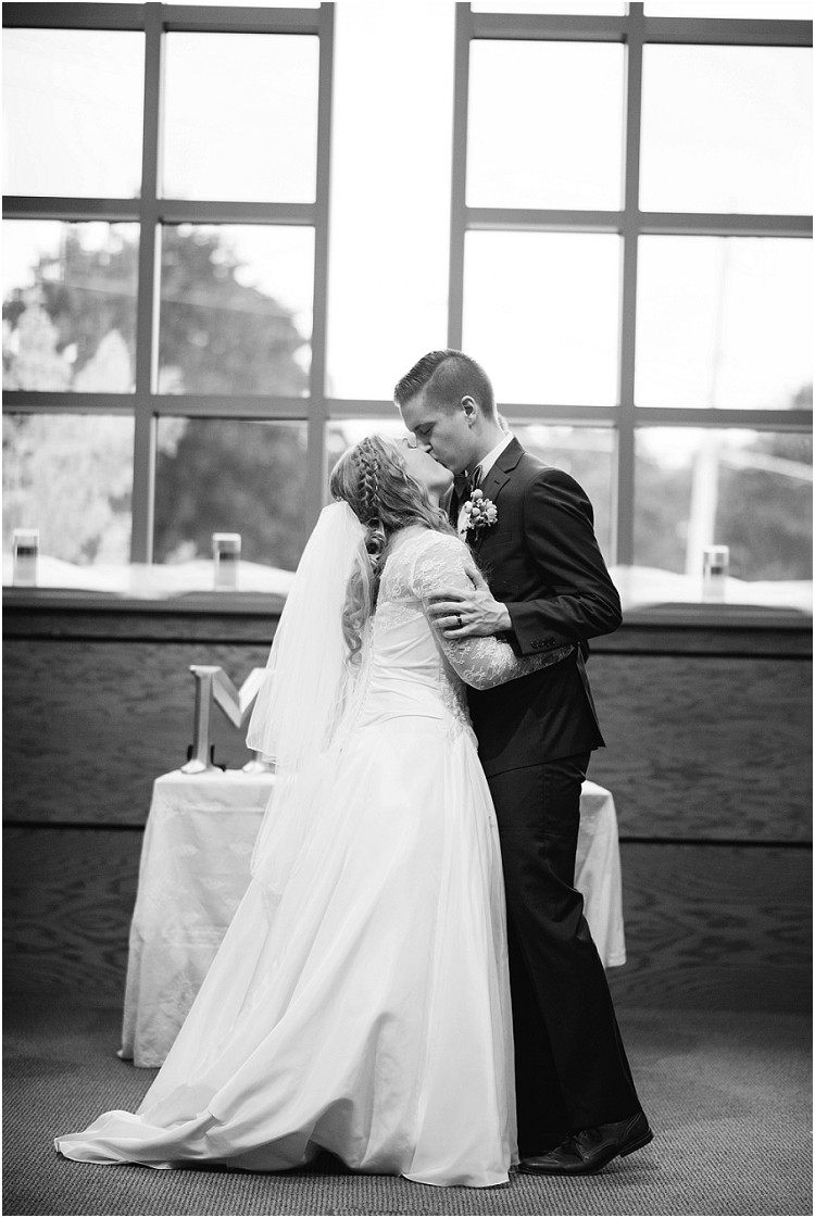 bride-and-groom-first-kiss-at-pamperin-park-wedding-by-appleton-wedding-photographer-kyra-rane-photography