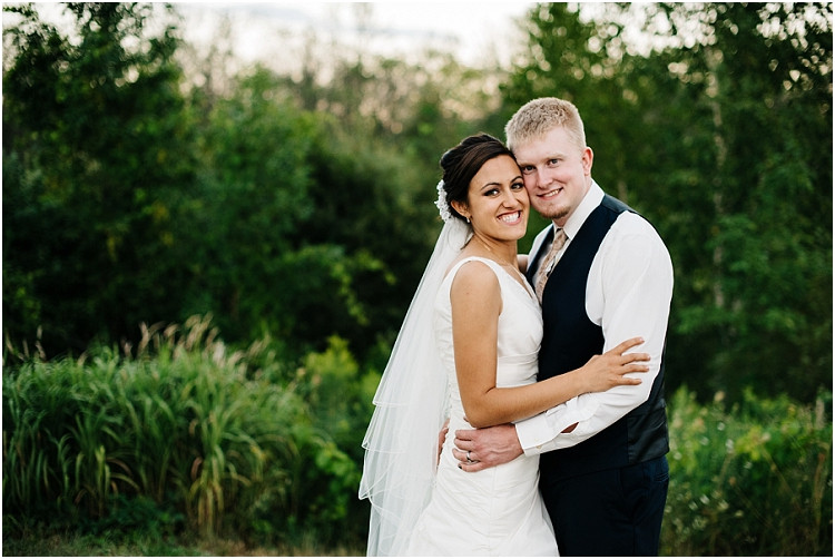 bride-and-groom-at-sunset-at-de-pere-wedding-by-appleton-wedding-photographer-kyra-rane-photography