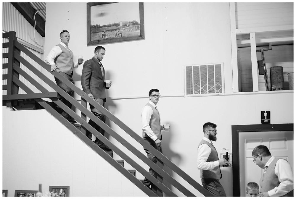groomsmen-walking-down-stairs-at-brighton-acres-wedding-by-green-bay-wedding-photographer-kyra-rane-photography