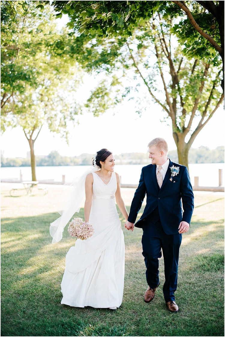 wedding-couple-walking-and-smiling-at-de-pere-wedding-by-green-bay-wedding-photographer-kyra-rane-photography