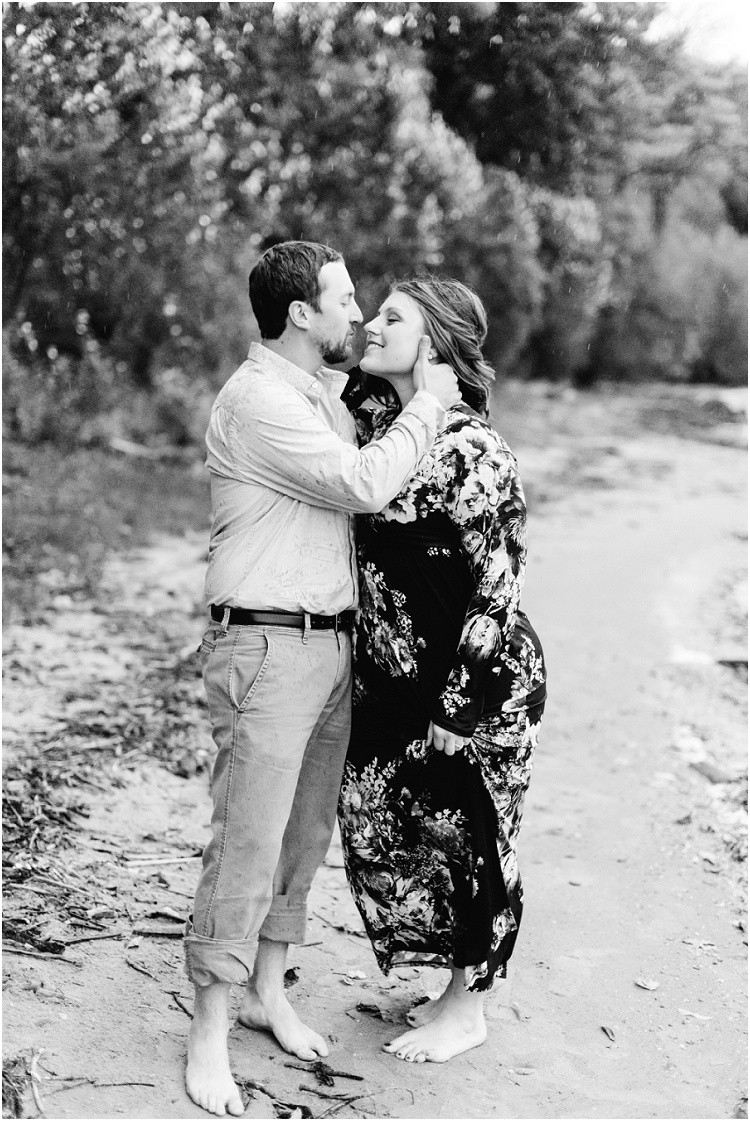 engaged-couple-almost-kiss-in-rain-at-high-cliff-engagement-session-by-appleton-wedding-photographer-kyra-rane-photography