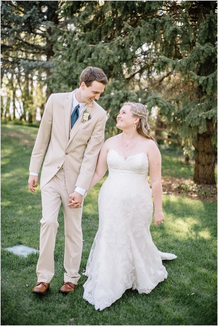 wedding-couple-smiling-at-each-other-walking-at-minnesota-wedding-by-milwaukee-wedding-photographer-kyra-rane-photography
