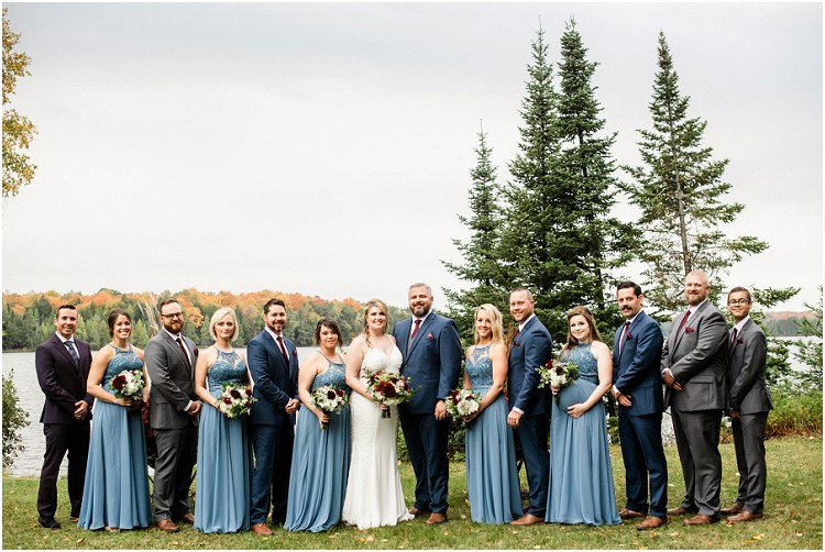 wedding-party-looking-at-camera-at-northern-wisconsin-autumn-wedding-by-green-bay-wedding-photographer-kyra-rane-photography