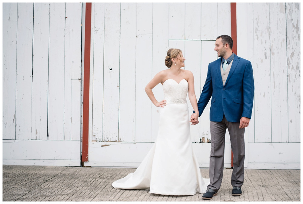 bride-and-groom-holding-hands-at-brighton-acres-wedding-by-milwaukee-wedding-photographer-kyra-rane-photography