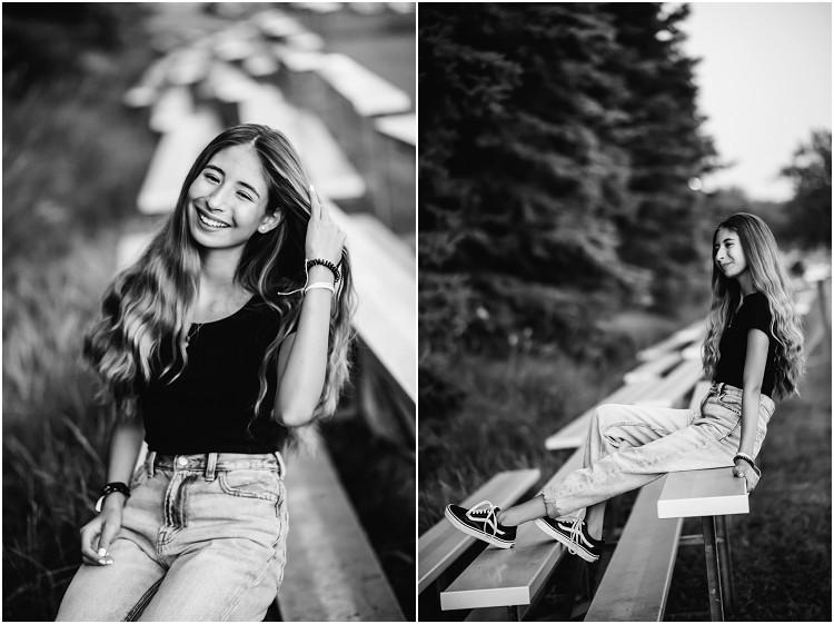 senior-laughing-on-bleachers-at-senior-session-at-plamann-park-by-milwaukee-wedding-photographer-kyra-rane-photography
