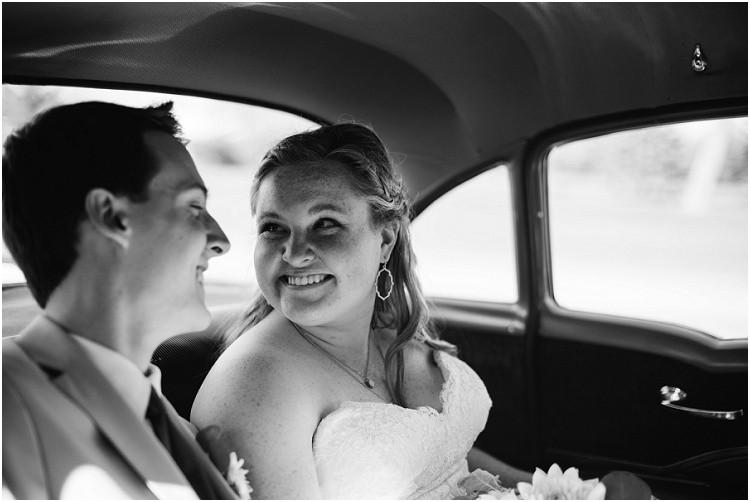 wedding-couple-in-getaway-car-at-minnesota-wedding-by-green-bay-wedding-photographer-kyra-rane-photography