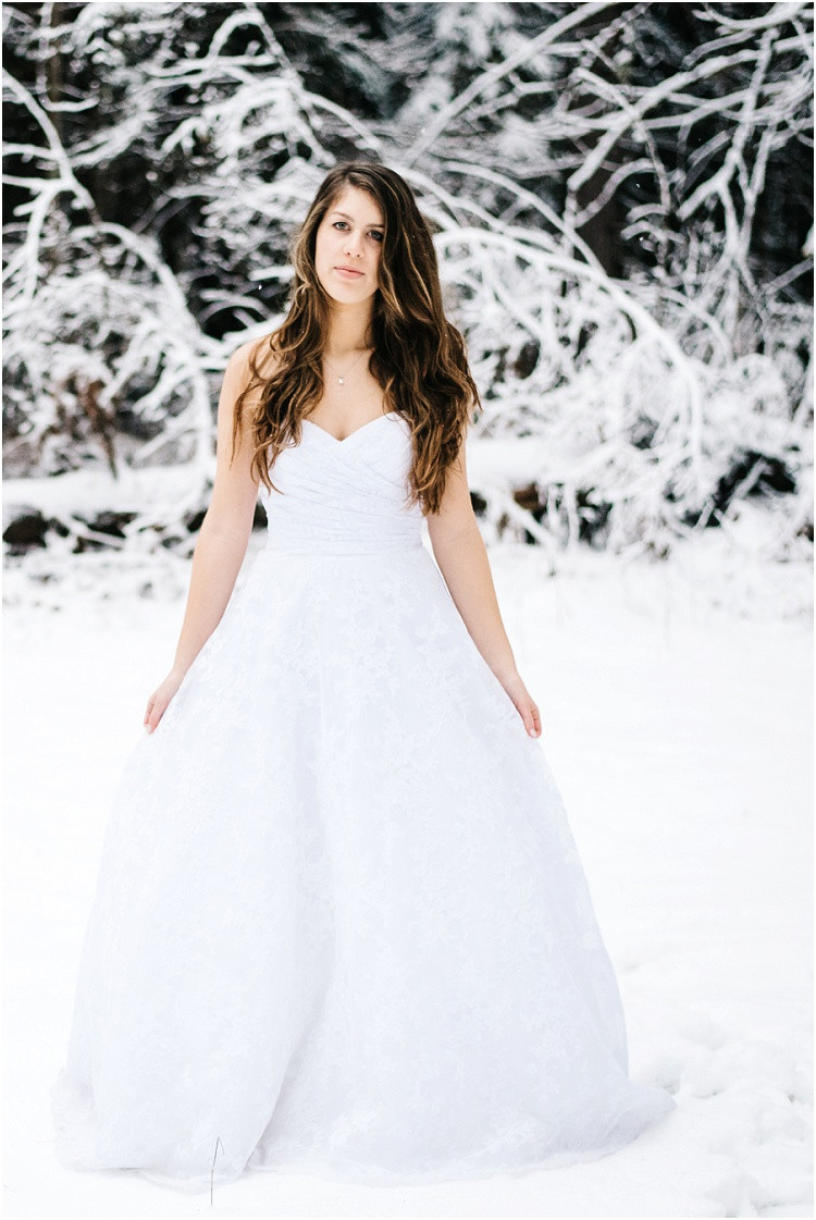 winter-bride-holding-sides-dress-at-wisconsin-winter-bridal-portraits-by-appleton-wedding-photographer-kyra-rane-photography