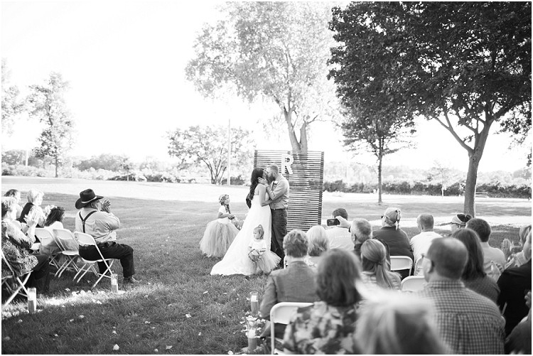 ceremony-kiss-at-little-chute-waterfront-wedding-by-appleton-wedding-photographer-kyra-rane-photography