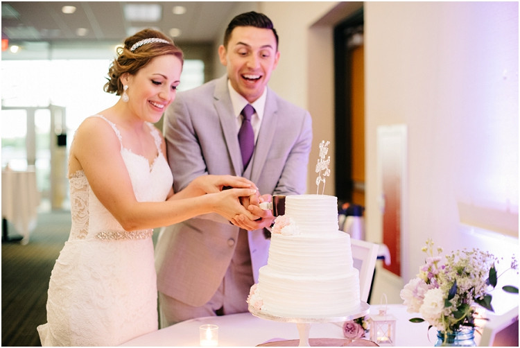 bride-and-groom-cutting-cake-at-best-western-premier-waterfront-hotel-wedding-by-green-bay-wedding-photographer-kyra-rane-photography