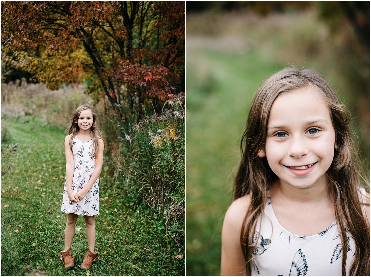 daughter-smiling-at-camera-at-fall-mini-session-favorites-by-green-bay-wedding-photographer-kyra-rane-photography