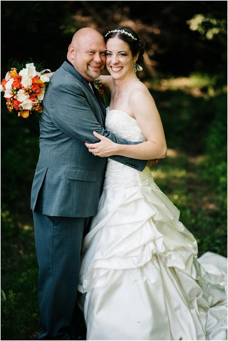 wedding-couple-smiling-at-camera-at-wisconsin-farm-wedding-by-appleton-wedding-photographer-kyra-rane-photography