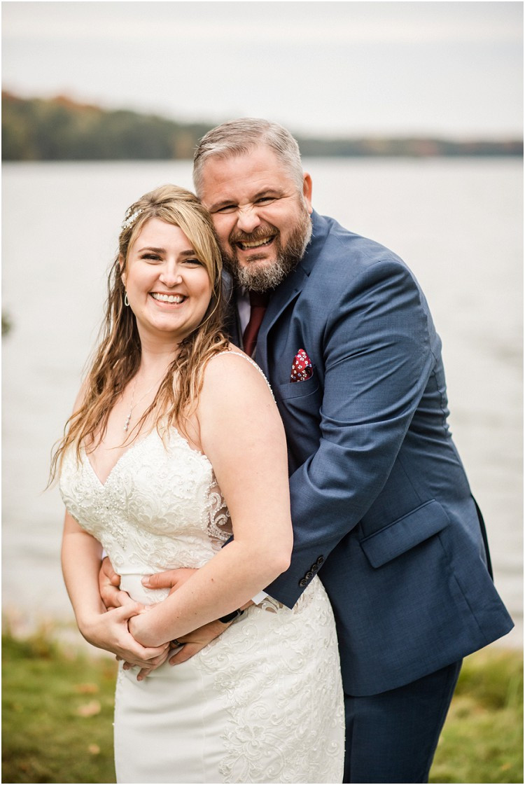 bride-and-groom-just-married-smiling-at camera-at-northern-wisconsin-autumn-wedding-by-milwaukee-wedding-photographer-kyra-rane-photography