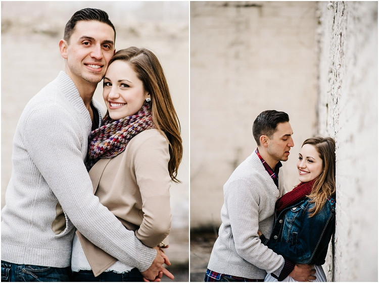 engaged-couple-behind-building-at-appleton-engagement-session-by-green-bay-wedding-photographer-kyra-rane-photography