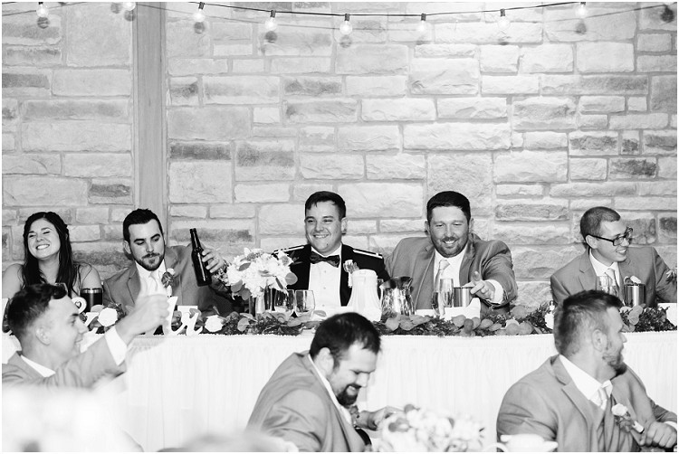 groomsmen-laughing-and-toast-at-de-pere-wisconsin-wedding-by-green-bay-wedding-photographer-kyra-rane-photography