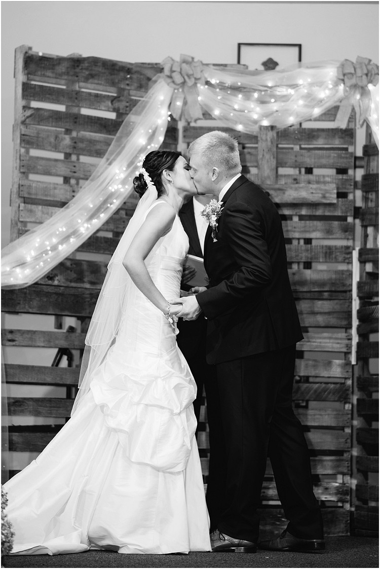 wedding-couple-first-kiss-at-de-pere-wedding-by-appleton-wedding-photographer-kyra-rane-photography