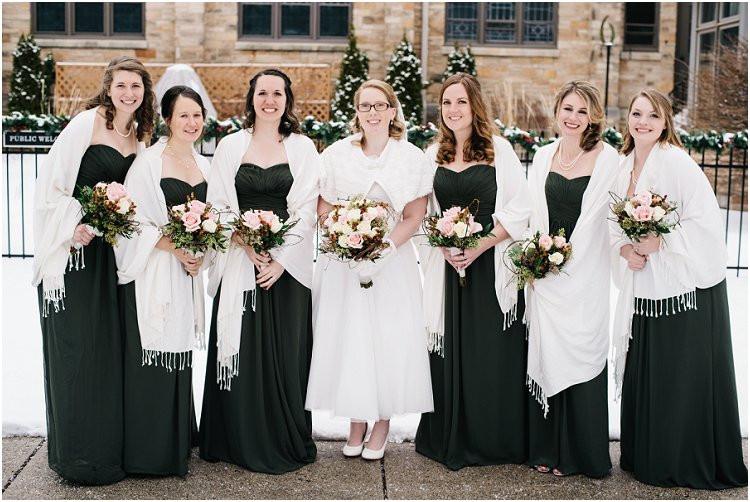 bride-with-bridal-party-smiling-at-camera-at-sheboygan-winter-wedding-by-appleton-wedding-photographer-kyra-rane-photography