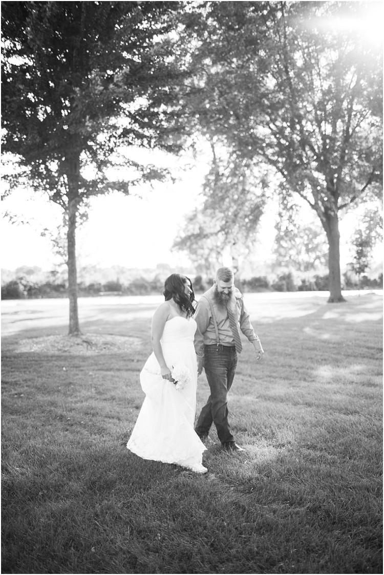 wedding-couple-walking-away-smiling--at-little-chute-waterfront-wedding-by-green-bay-wedding-photographer-kyra-rane-photography