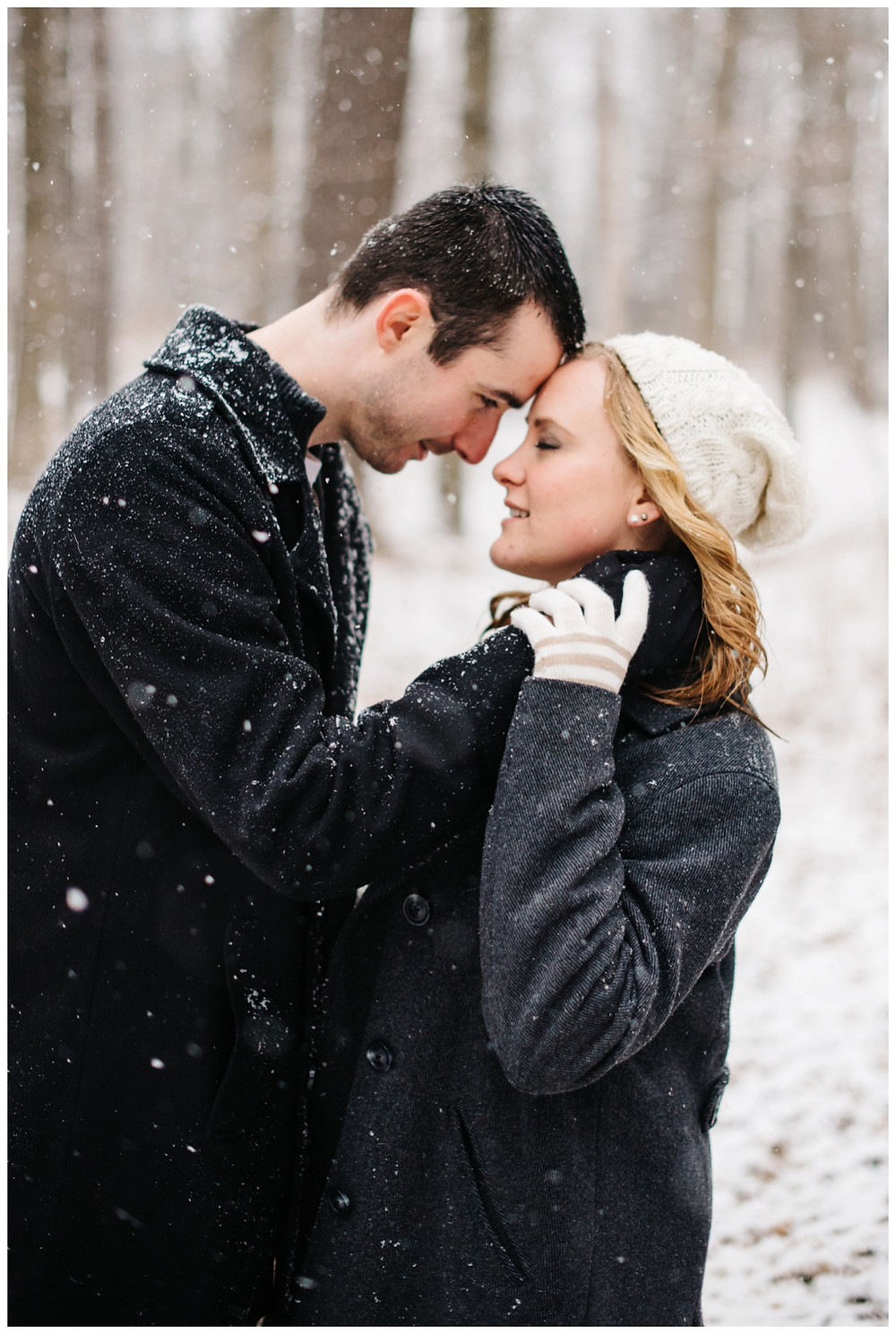man-looking-into-fiances-eyes-at-snowy-sheboygan-engagement-session-by-green-bay-wedding-photographer-kyra-rane-photography