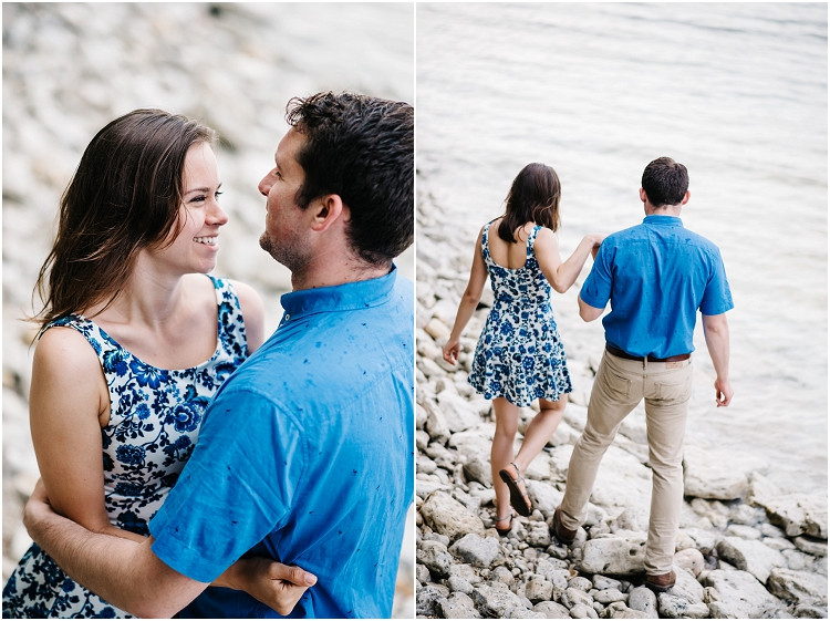 engaged-couple-walking-walking-on-beach-rocks-at-cave-point-engagement-session-by-milwaukee-wedding-photographer-kyra-rane-photography