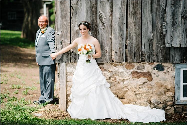 wedding-couple-holding-hands-at-wisconsin-farm-wedding-by-appleton-wedding-photographer-kyra-rane-photography