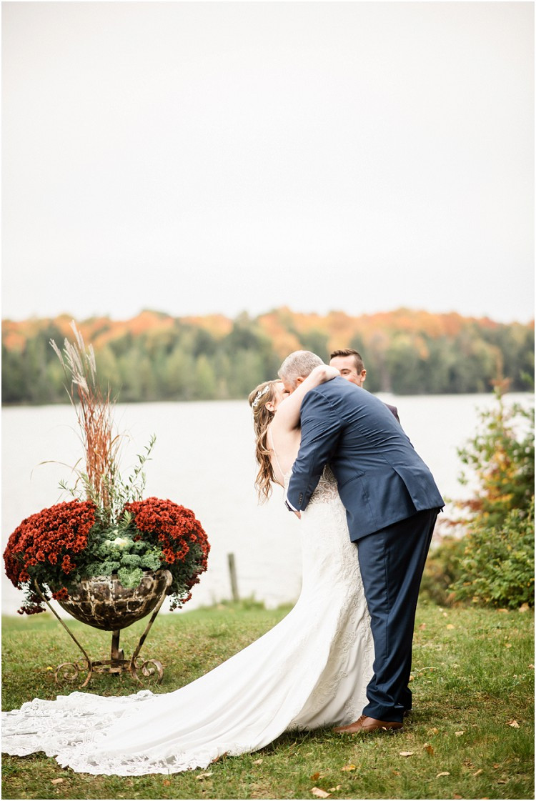bride-and-groom-first-kiss-at-northern-wisconsin-autumn-wedding-by-milwaukee-wedding-photographer-kyra-rane-photography