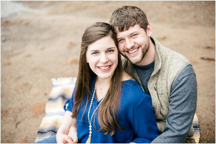 engaged-couple-sitting-smiling-at-camera-at-northwoods-lakeside-engagement-session-by-appleton-wedding-photographer-kyra-rane-photography