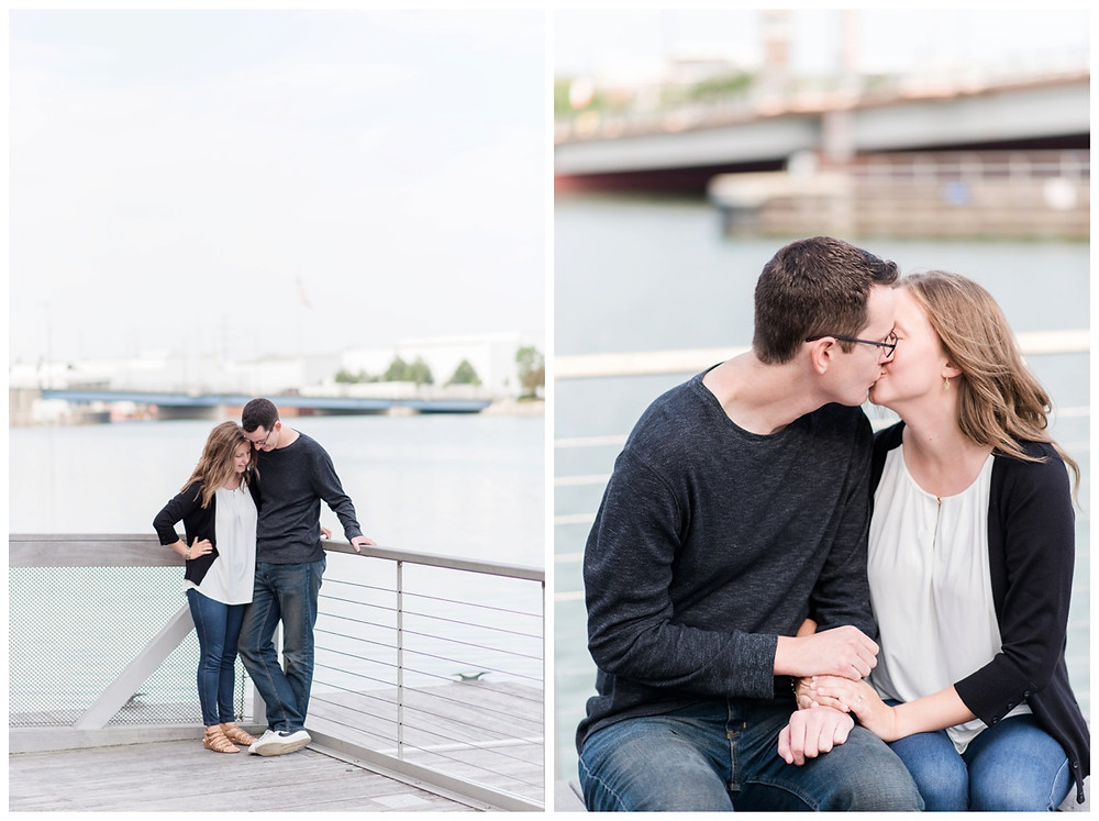 engaged-couple-kissing-on-bench-at-downtown-green-bay-engagement-session-by-appleton-wedding-photographer-kyra-rane-photography
