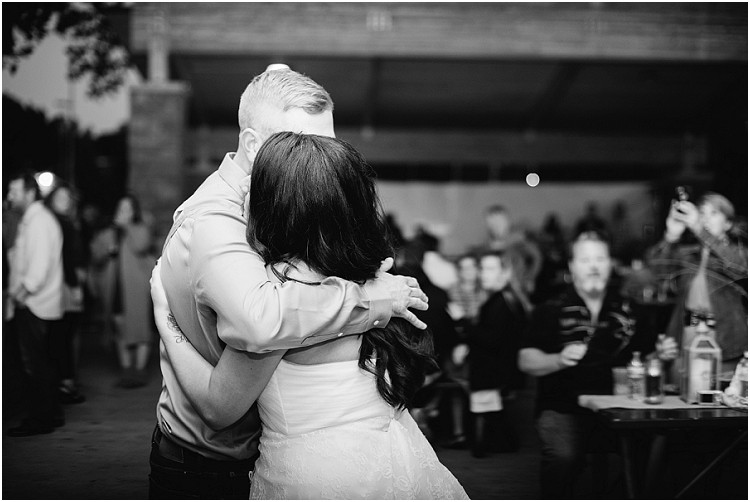 wedding-couple-hugging-each-other-at-little-chute-waterfront-wedding-by-appleton-wedding-photographer-kyra-rane-photography