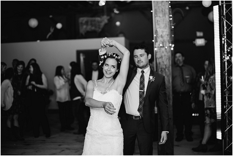 wedding-couple-first-dance-twirl-at-barnsite-retreat-and-events-wedding-by-milwaukee-wedding-photographer-kyra-rane-photography