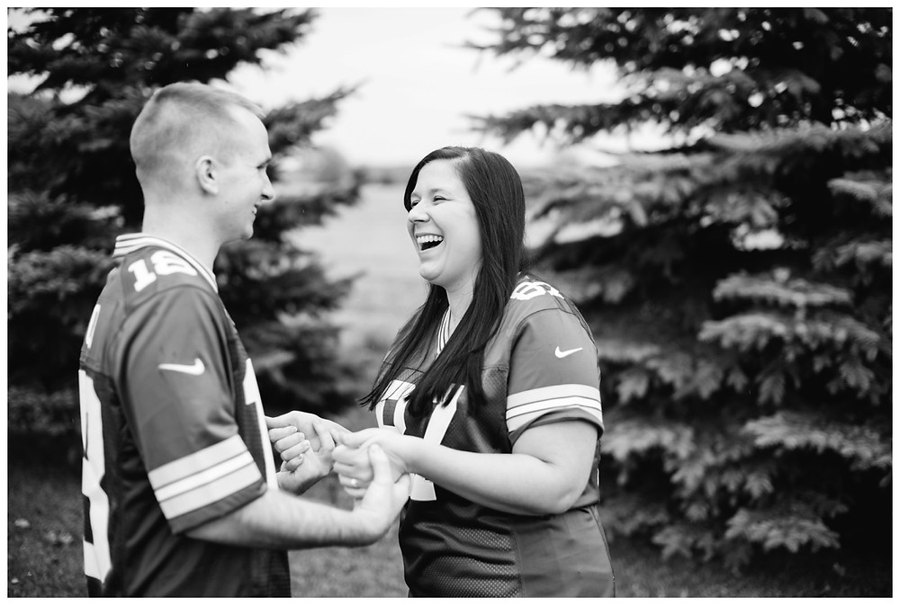 couple-holding-hands-laughing-at-green-bay-engagement-session-by-green-bay-wedding-photographer-kyra-rane-photography