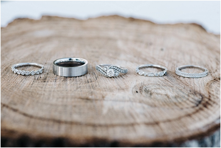 wedding-rings-on-wood-at-little-chute-waterfront-wedding-by-green-bay-wedding-photographer-kyra-rane-photography