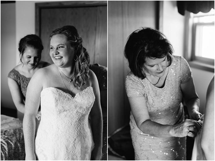 bride-getting-into-dress-at-minnesota-wedding-by-milwaukee-wedding-photographer-kyra-rane-photography