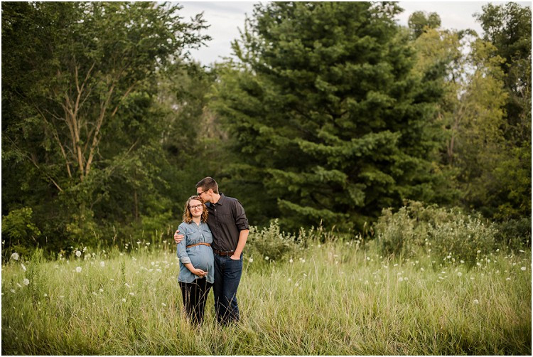 expecting-couple-standing-in-field-at-plamann-park-maternity-session-by-milwaukee-wedding-photographer-kyra-rane-photography