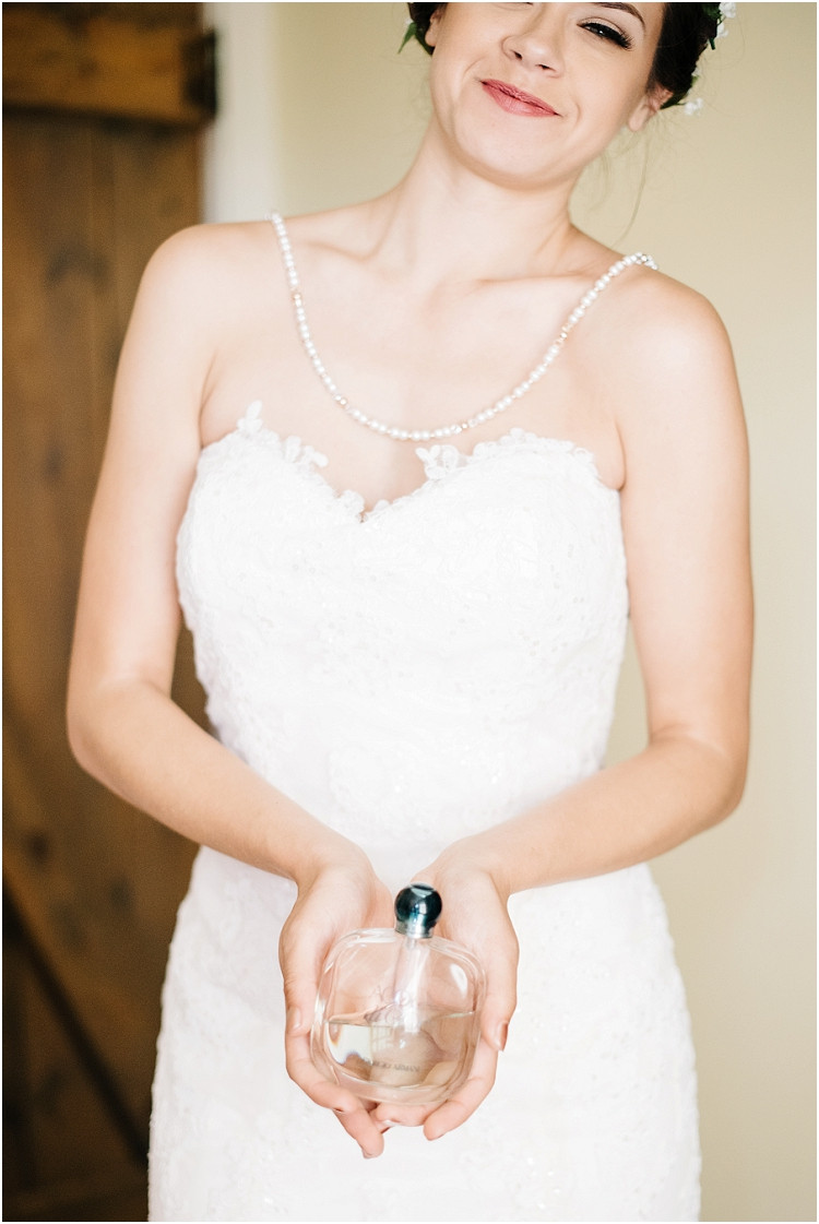 bride-with-perfume-at-barnsite-retreat-and-events-wedding-by-appleton-wedding-photographer-kyra-rane-photography