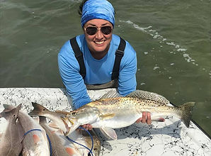 Elizabeth Kohutek wade fishing for Redfish and caught a 27 5/8' Trophy Size Trout.