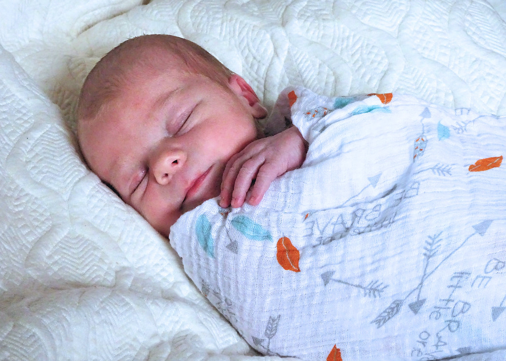 how to swaddle baby, best way to swaddle baby, should I swaddle baby at night, does a swaddle help baby sleep, when should I stop swaddling baby, Little Bell Sleep Solutions