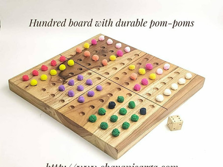 Hundred board with durable pom-poms