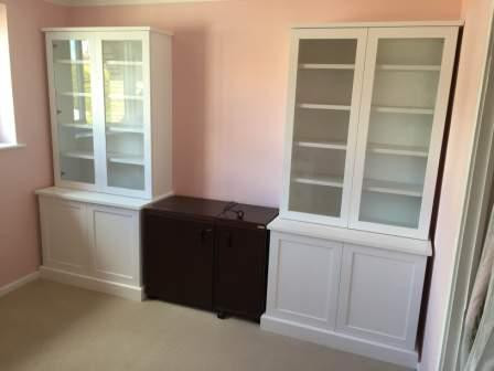 Sewing room storage with glass doors