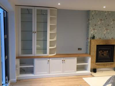 White lounge storage with glass panel doors
