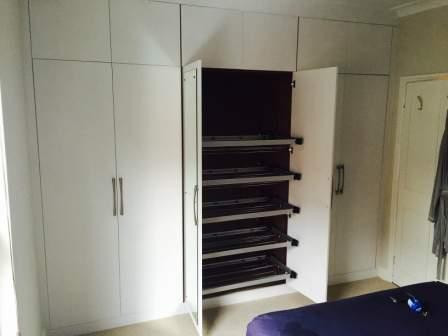 Contemporary wardrobe with walnut interior