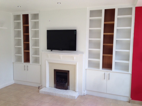 Fitted white and oak lounge storage unit
