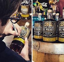 Justin Signing Bottles.jpg